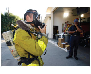 The figure shows a rescue worker in a mask connected to an air cylinder.